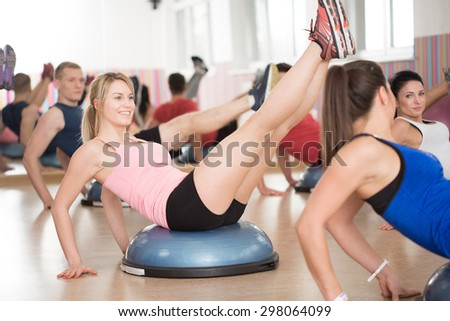 View of bosu training in fitness club - stock photo