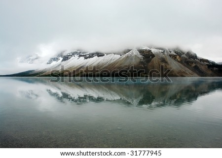 View of bow lake after a sudden summer snow in august, banff national park, alberta - stock photo