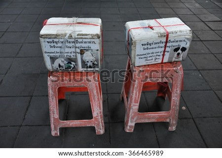 View of Boxes Requesting Donations for Dogs on a Street in Bangkok Thailand - stock photo