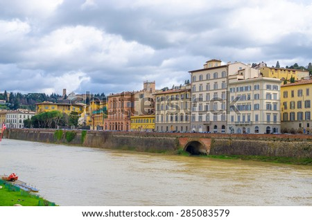 view of bridge Ponte Vecchio and Arno river in Florence, Italy