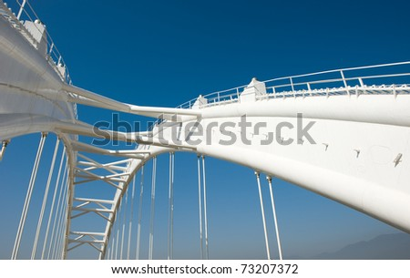 View of bridge support against a blue sky. - stock photo