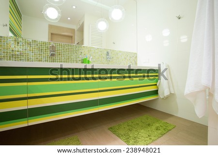 View of bright bathroom with green elements - stock photo