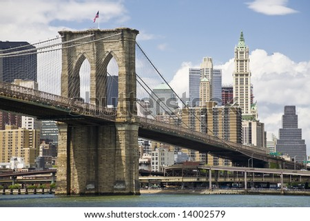 View of Brooklyn bridge and Manhattan from the East river - stock photo