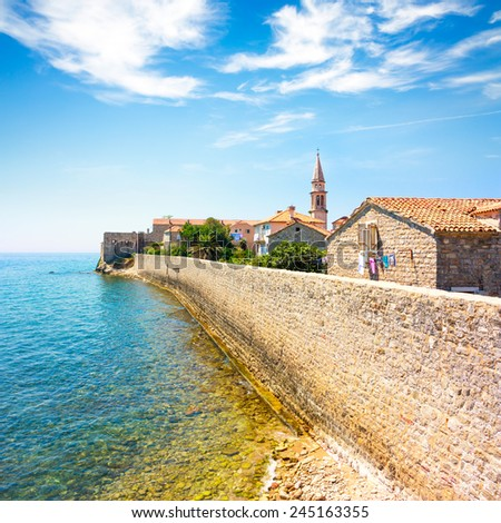 View of Budva Old Town Citadel and Blue Sea. Montenegro, Balkans, Adriatic Sea. European Summer Resort in Mediterranean. Copy Space. - stock photo
