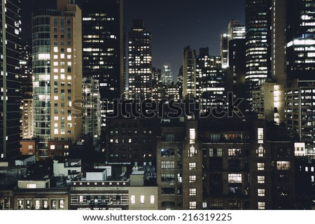 View of buildings in the Turtle Bay neighborhood at night, from a rooftop on 51st Street in Midtown Manhattan, New York. - stock photo