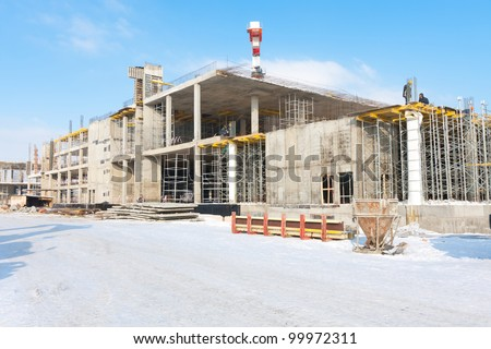 view of business center being built with peoples and technics - stock photo