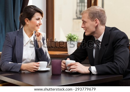 View of business partners during coffee break - stock photo