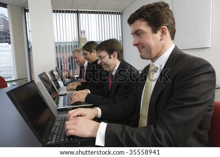 View of  business people working on computers in the office. - stock photo
