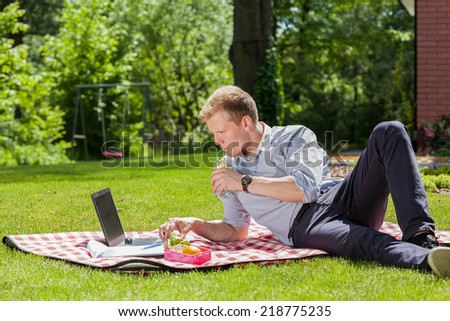 View of businessman relaxing in a garden