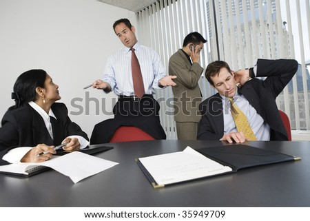View of businesspeople in an office meeting. - stock photo