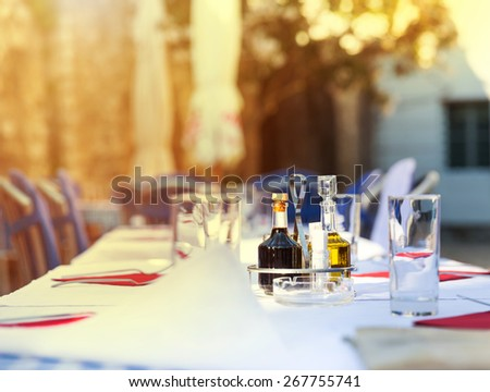View of cafe in narrow street - stock photo