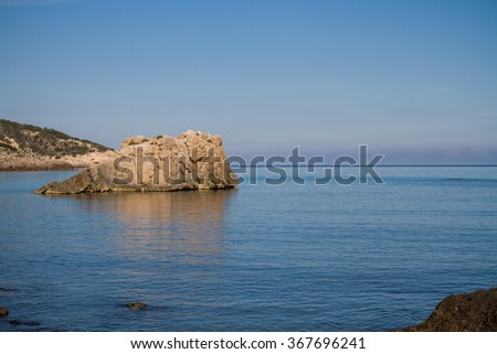 View of Cala Xarraca, beautiful and famous beach of Ibiza with amazing clear and blue turquoise water in a beautiful summer day, Balearic Islands, Spain. - stock photo