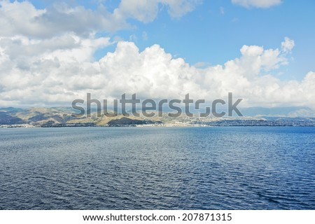 view of Calabria, Italy coastline from Strait of Messina in summer day - stock photo