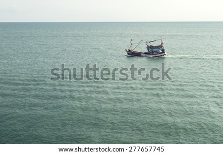 view of calm sea horizon and single fisherman. old professions concept - stock photo