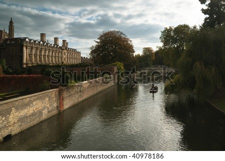 View of Cam river with ponters  and the ornamented facade of Clare College - stock photo