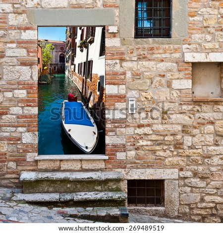 View of Canal  in Venice through the Window - stock photo