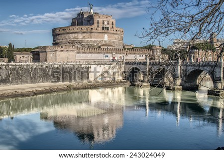 View of Castel Sant'Angelo and the bridge of the same name from the quay of the river Tiber in Rome, italy - stock photo