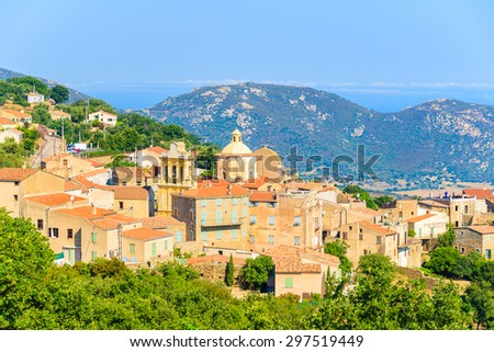 View of Cateri village with stone houses built in traditional Corsican style on top of a hill, France - stock photo