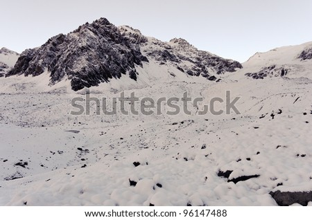 View of Cathedral mountain from Plaza de Mulas base camp, just after a snow storm. Aconcagua Provincial Park, Mendoza, Argentina, South America. - stock photo