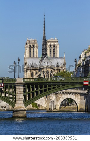 View of Cathedral Notre Dame de Paris from river Seine. Cathedral Notre Dame de Paris - most famous Gothic, Roman Catholic cathedral (1163-1345) on the eastern half of the Cite Island. France, Europe. - stock photo