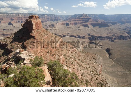 View of Cedar Ridge and Grand Canyon in harsh midday sun as seen from the South Kaibab Trail - stock photo