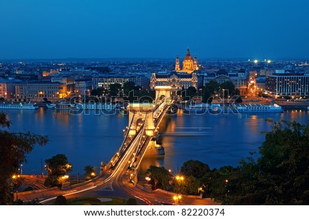 View of Chain Bridge and St. Stephen's Basilica at night. - stock photo