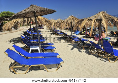 view of chairs and umbrella on the beach - stock photo