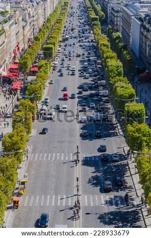 View of champs elysees boulevard with a lot of traffic. - stock photo