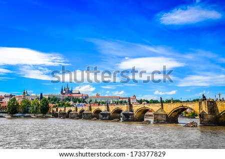 View of Charles Bridge and Prague Castle from the river Vltava, Czech Republic - stock photo