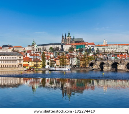 View of Charles bridge over Vltava river and Gradchany (Prague Castle) and St. Vitus Cathedral - stock photo