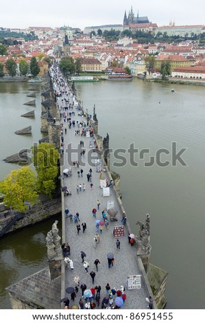 View of Charles Bridge with the Prague Castle behind, from the tower located on the Old Town side. - stock photo