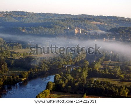 View of Chateau de Beynac at sunrise. Taken from a hot air balloon. - stock photo