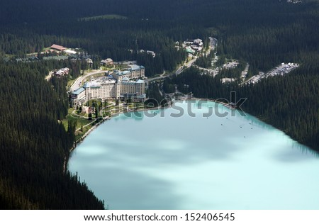 View of Chateau Lake Louise, Banff National Park, Alberta, Canada. View is from the top of the Devil's Thumb.  - stock photo