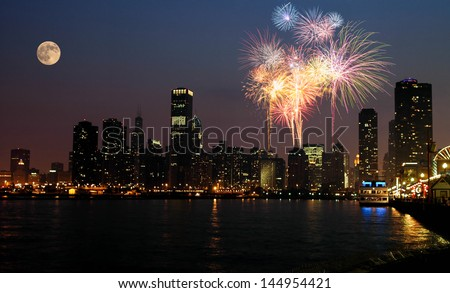 View of Chicago downtown and Navy Pier with grand fireworks and super moon - stock photo