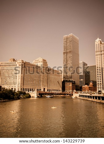 View of Chicago skyline with summer haze effect as viewed from wacker driver - vintage concept - stock photo