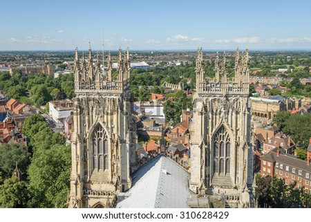 View of church spires and the city of York, England from atop York Minster - stock photo