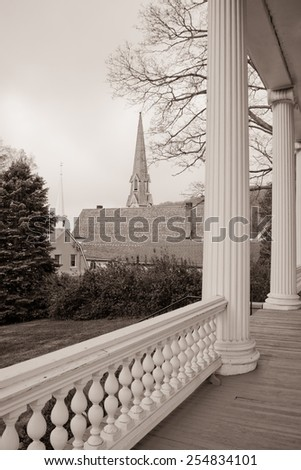 View of church steeples taken from a porch. - stock photo