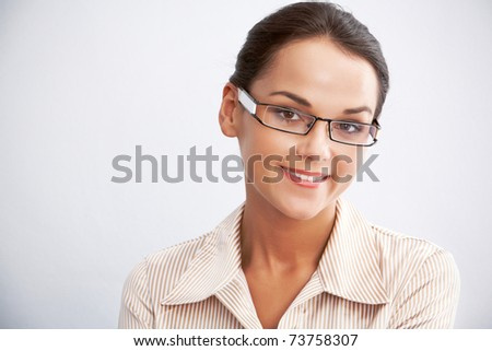 View of clever businesswoman on a blue background