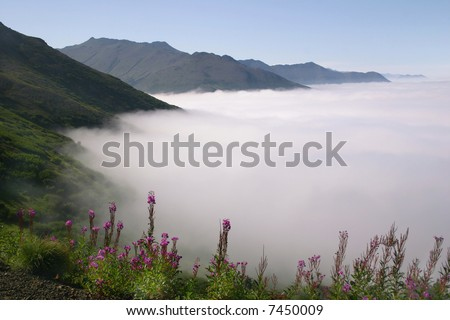 View of clouds over the Kenai Peninsula from Flattop Mountain, high above Anchorage, Alaska - stock photo
