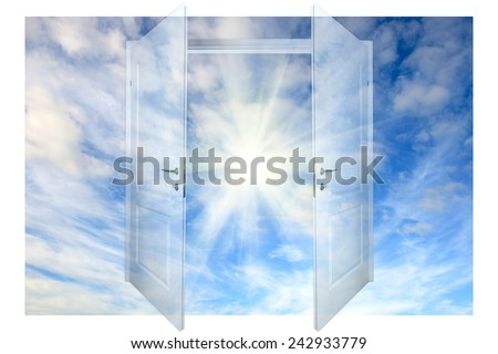 view of cloudy sky and sun  through open door - stock photo