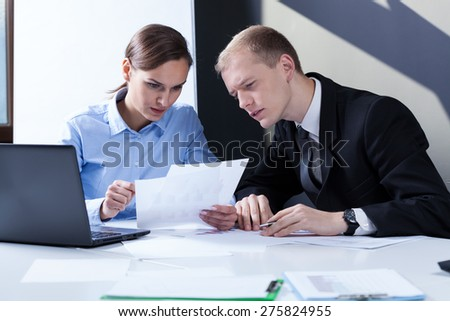 View of co-workers working together at work - stock photo