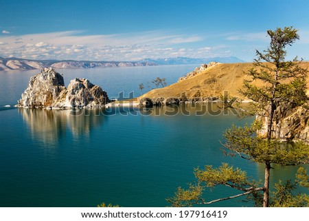 View of coast of Baikal lake, Shaman rock and cape Burhan on Olkhon Island, Russia