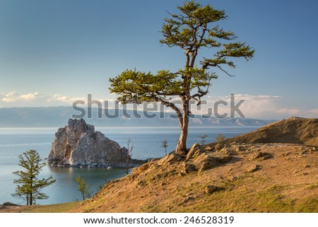 View of coast of Baikal lake, Shaman rock, the tree of desires and cape Burhan on Olkhon Island, Russia - stock photo