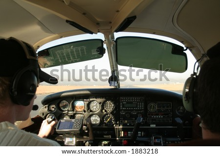 View of cockpit of plane while flying - stock photo