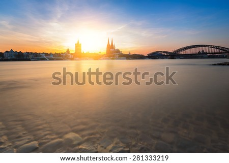 view of Cologne at sunset on the Promenade shore - stock photo