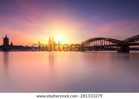 view of Cologne in germany at sunset - stock photo