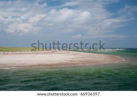 View of colorful cape cod beach from the ocean in the summer time - stock photo