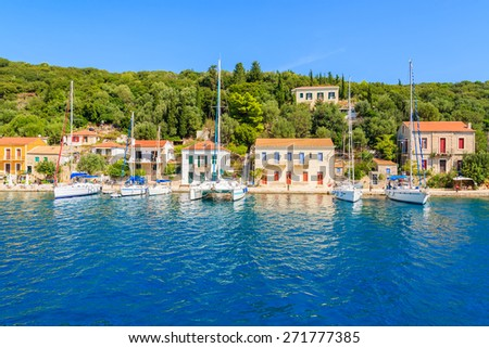 View of colorful houses and sailing boats in Kioni port on Ithaka island, Greece - stock photo