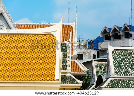 View of colorful oriental rooftops from Wat Traimit temple Bangkok, Thailand. Selective focus - stock photo