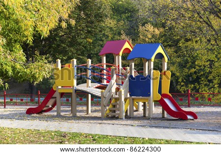 View of colorful playground in a autumn city park